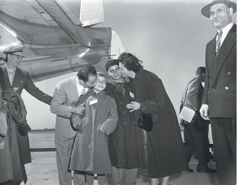 Greek family reunites at Malton Airport, 1955. Image no. ASC02581.