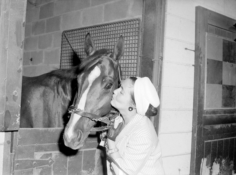 Mrs. Robert Marshal gives a horse a kiss, 1960.  Image no. ASC03720.