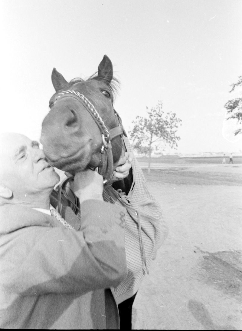 Trainer kisses his horse at the Woodbine Racetrack's Queen's Plate in 1961. Image no. ASC03903.